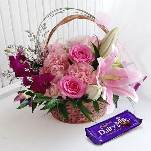 Beautiful Flower Arrangement with a Cadburys Chocolate Box with Love