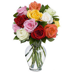 Delightful Assemble of Mixed Roses in a Glass Vase