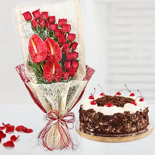 Captivating Red Roses n Anthodium Bouquet with Black Forest Cake
