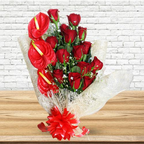 Amusing Red Roses N Anthurium Bouquet Wrapped in Tissue