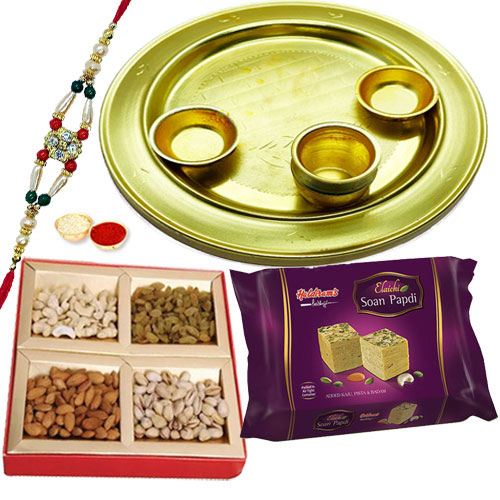 Dazzling Display of Decorative Silver Plated Thali, Soan Papdi and Mixed Dry Fruits along with Free Rakhi, Roli Tilak and Chawal for your Beloved Brother